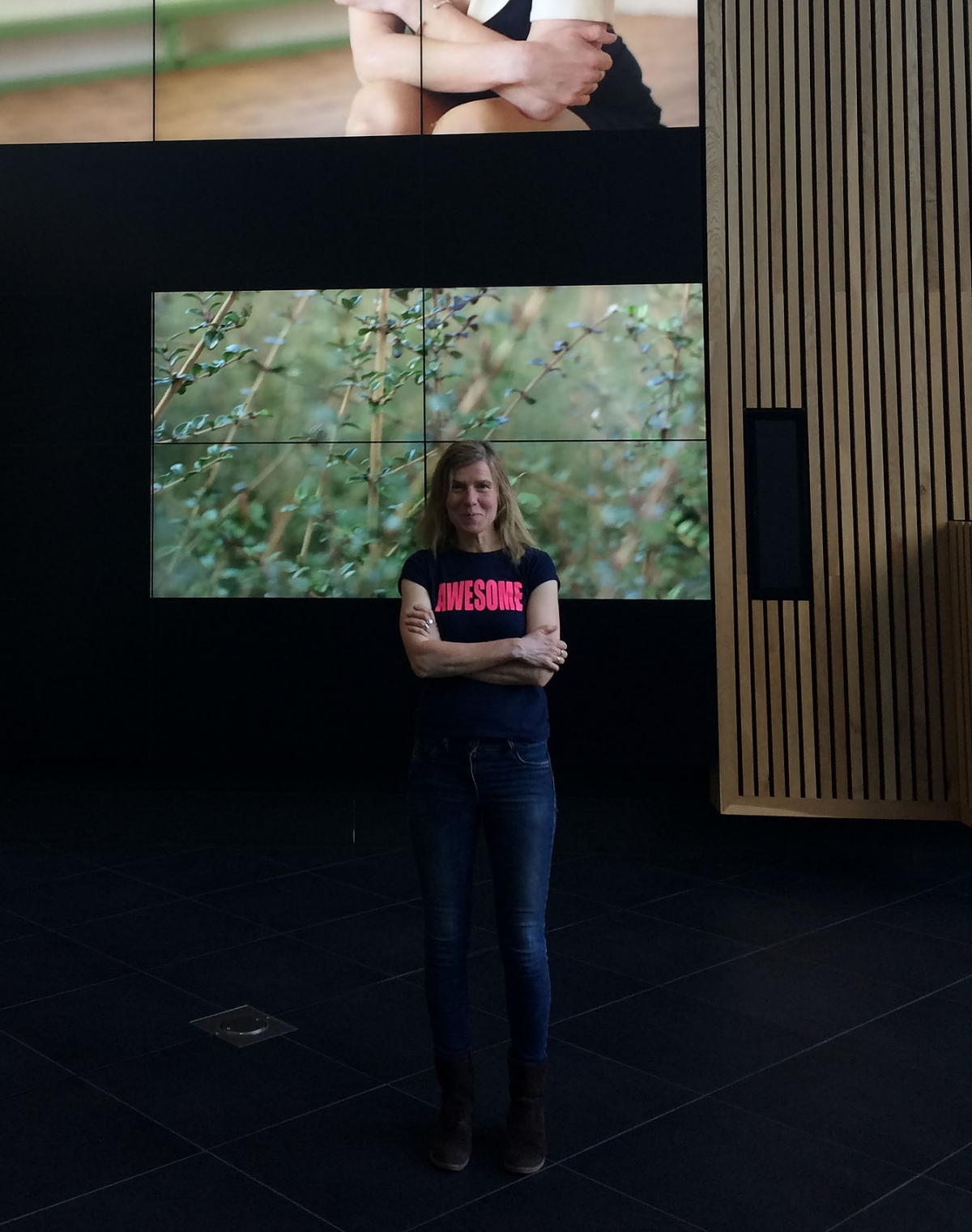 Katrina McPherson standing in front of her work on the MediaWall at Bath Spa University.