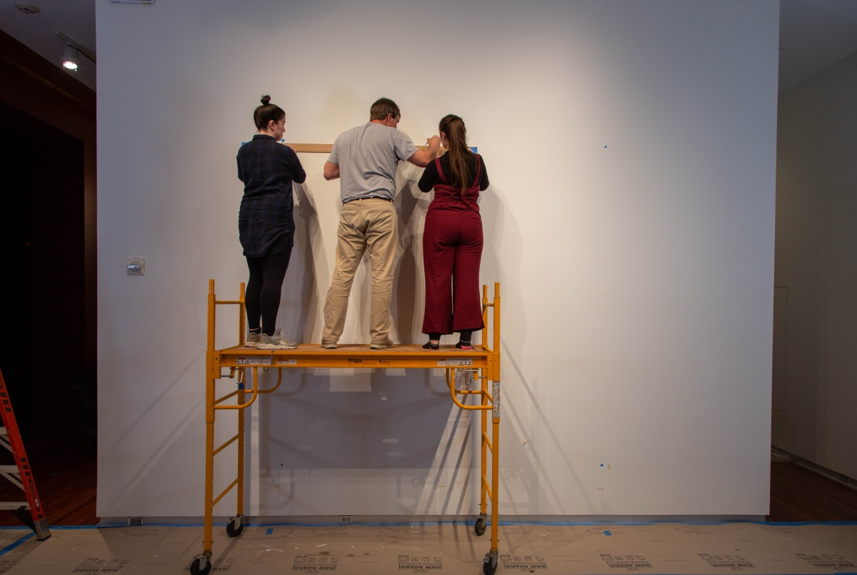 "Student drawers working with Draftsman Roland Lusk at UMFA to install newly acquired Sol LeWitt work ""Wall Drawing #33"""